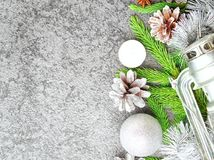 Christmas and Happy New Year gray stone background. Top view, copy space, military stile. Fir branches, silver concrete. Christmas and Happy New Year gray stone Stock Photos
