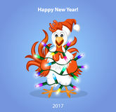 Christmas and Happy New Year Greeting Card with Cute Funny Rooster Wrapped in christmas Lights. Merry Christmas and Happy New Year Greeting Card with Cute Funny Royalty Free Stock Photo