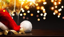 Christmas and happy New year party background; champagne and San stock image