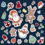 Christmas and Happy new year patch badges. With Santa, Deer, Snowman, Fir-tree and other symbols of Holidays. Vector doodle illustrations  on blue background Royalty Free Stock Photos