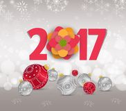 Christmas and Happy new year 2017 with red bauble, snow and snowflakes Stock Images