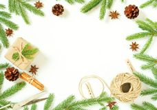 Christmas and Happy New Year white background. Gift Christmas box, fir branches, wooden table, top view, copy space. Christmas and Happy New Year white royalty free stock images
