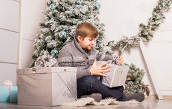 Christmas - happy smiling caucasian man opens gift box stock photography