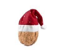Christmas hat. Christmas; decorations; hat; holiday; peseasonal; red; santa; season; seasonal; white; x-mas; xmas, feed, cafe, warm, commodities, natural royalty free stock image
