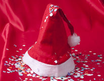 Christmas hat. On red background stock photos