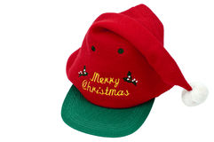 Christmas hat. A red Christmas hat decorated with green leafs and the words: Merry Christmas. It is isolated on a white background Stock Photos