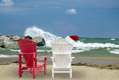 Christmas hat on Adirondack chair Stock Photos