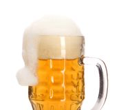 Christmas hat as foam in big mug of beer. Stock Photos