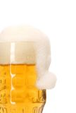 Christmas hat as foam in big mug of beer. Stock Photography