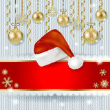 Christmas hat and baubles on knitted background Stock Images