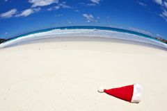 Christmas hat is on a beach Stock Photo