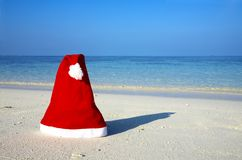 Christmas hat on a beach Stock Photo