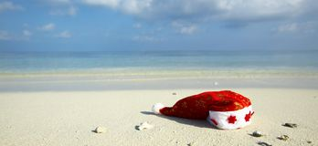 Christmas hat on a beach Stock Images