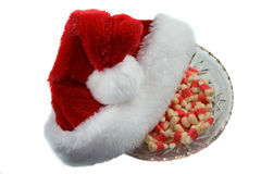 Christmas hat and candy. Stock Photos