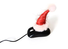 Christmas Hat on Computer Mouse Stock Image