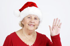 Christmas hat grandma waving hello Royalty Free Stock Images