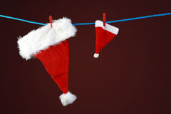 Christmas hat hang on a rope Royalty Free Stock Photography