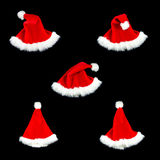 Christmas hat isolate black red five style. Christmas hat on black isolate five style Royalty Free Stock Images