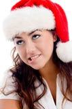 christmas hat looking upward wearing woman Στοκ εικόνα με δικαίωμα ελεύθερης χρήσης