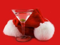 Christmas hat with martini. Isolated on a red background Royalty Free Stock Photos