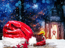 Christmas hat, mulled wine and lantern royalty free stock image