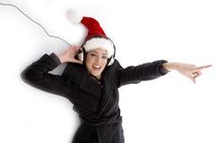 christmas hat pointing woman Στοκ Εικόνες