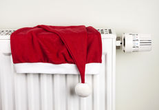 Christmas hat and radiator Stock Photo