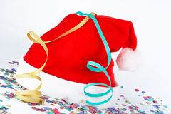 Christmas hat with ribbons and confetti Royalty Free Stock Photo