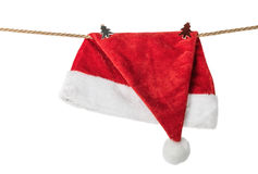 Christmas Hat Santa claus hanging on a rope with clothespins Stock Images