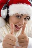 christmas hat showing thumbs up wearing woman Στοκ εικόνες με δικαίωμα ελεύθερης χρήσης