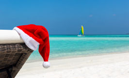 Christmas hat on a sunbed at a tropical beach royalty free stock photos