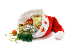 Christmas hat with toys on white. A christmas Santa hat with gift and toys Royalty Free Stock Images
