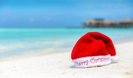Christmas hat on tropical beach stock photography