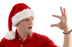 Christmas hat wearing male looking at palm Stock Photography