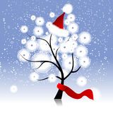 Christmas hat on winter tree Royalty Free Stock Image