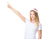 Christmas hat woman and finger point up Royalty Free Stock Image