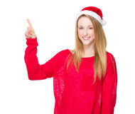 Christmas hat woman with finger point up Stock Photo