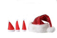 Christmas hats. In various sizes on white background Royalty Free Stock Images