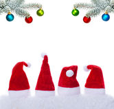 Christmas hats and baubles Stock Images