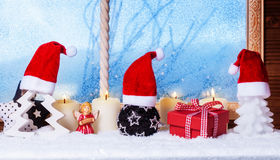 Christmas hats, candles, gift, angel Stock Image