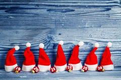 Christmas hats, Christmas tree balls Royalty Free Stock Photography