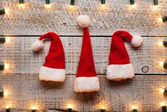 Christmas hats and decorative lights frame background royalty free stock photos