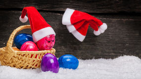 Christmas hats hanging on a nail, Easter eggs. With face Stock Image