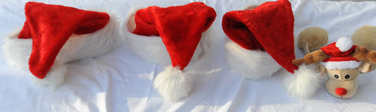 Christmas Hats and Rudolph Royalty Free Stock Images