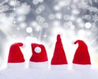 Christmas hats and snowflakes Royalty Free Stock Photos