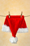 Christmas headdress on a rope. A red new-year head-dress  hangs on a rope Stock Photo