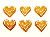 Christmas heart cookies. Gingerbread heart cakes with a smile - isolated on white background Royalty Free Stock Images