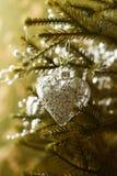 A Christmas heart hanging on a Christmas tree Royalty Free Stock Image