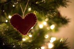Christmas heart. Little hand made heart on the Christmas tree Stock Images