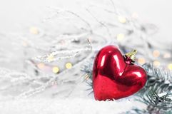 Christmas heart ornament in the snow. Red Christmas heart ornament in the snow stock image